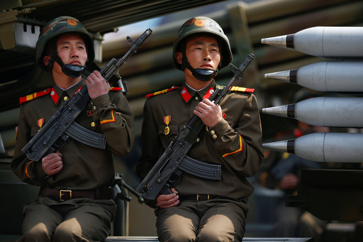 Soldiers hold weapons while sitting on a vehicle carrying rockets as it drives past the stand with North Korean leader Kim Jong Un during a military parade marking the 105th birth anniversary of the country's founding father, Kim Il Sung in Pyongyang, April 15, 2017. REUTERS/Damir Sagolj
