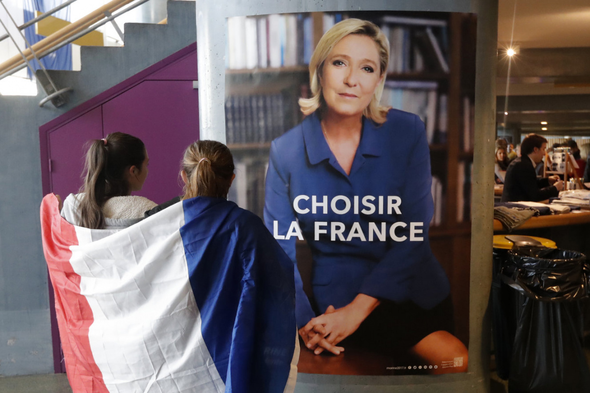 Supporters for Marine Le Pen, French National Front (FN) political party leader and candidate for French 2017 presidential election, arrive to attend a campaign rally in Nice, France, April 27, 2017. REUTERS/Eric Gaillard