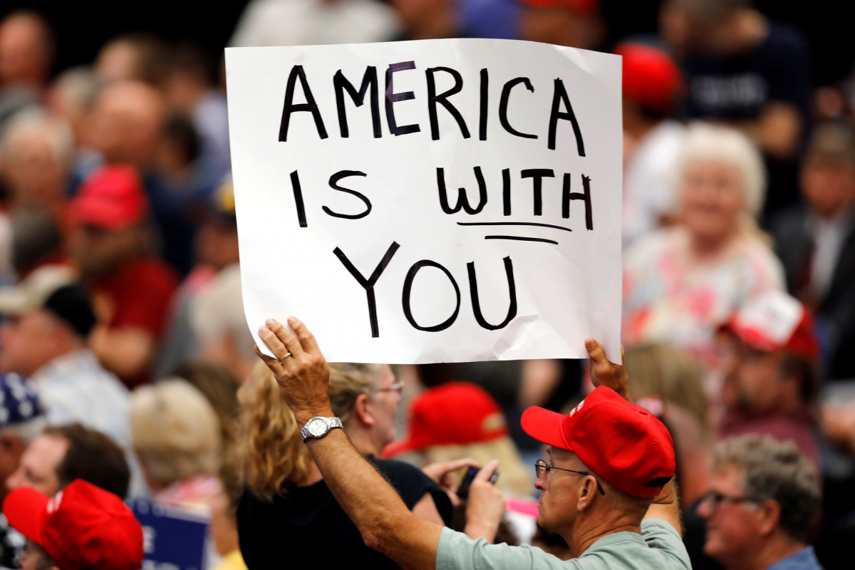 A supporter holds a sign during a rally with President Donald Trump at the U.S. Cellular Center in Cedar Rapids, Iowa, U.S. June 21, 2017. REUTERS/Scott Morgan