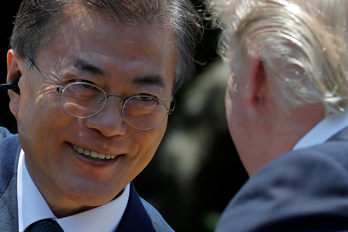 South Korean President Moon Jae-in looks at U.S. President Donald Trump after delivering a joint statement from the Rose Garden of the White House in Washington, U.S., June 30, 2017. REUTERS/Carlos Barria