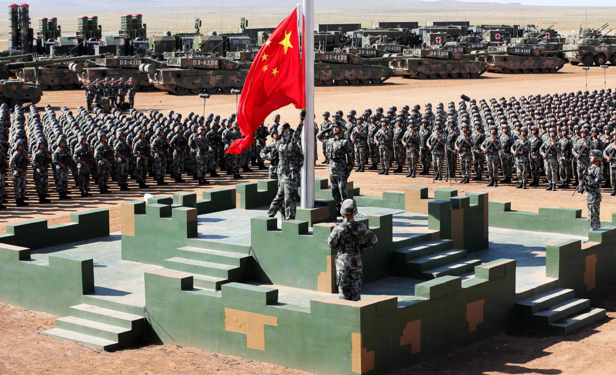 Soldiers of China's People's Liberation Army (PLA) raise a Chinese national flag during the military parade to commemorate the 90th anniversary of the foundation of the army at Zhurihe military training base in Inner Mongolia Autonomous Region, China, July 30, 2017. China Daily via REUTERS