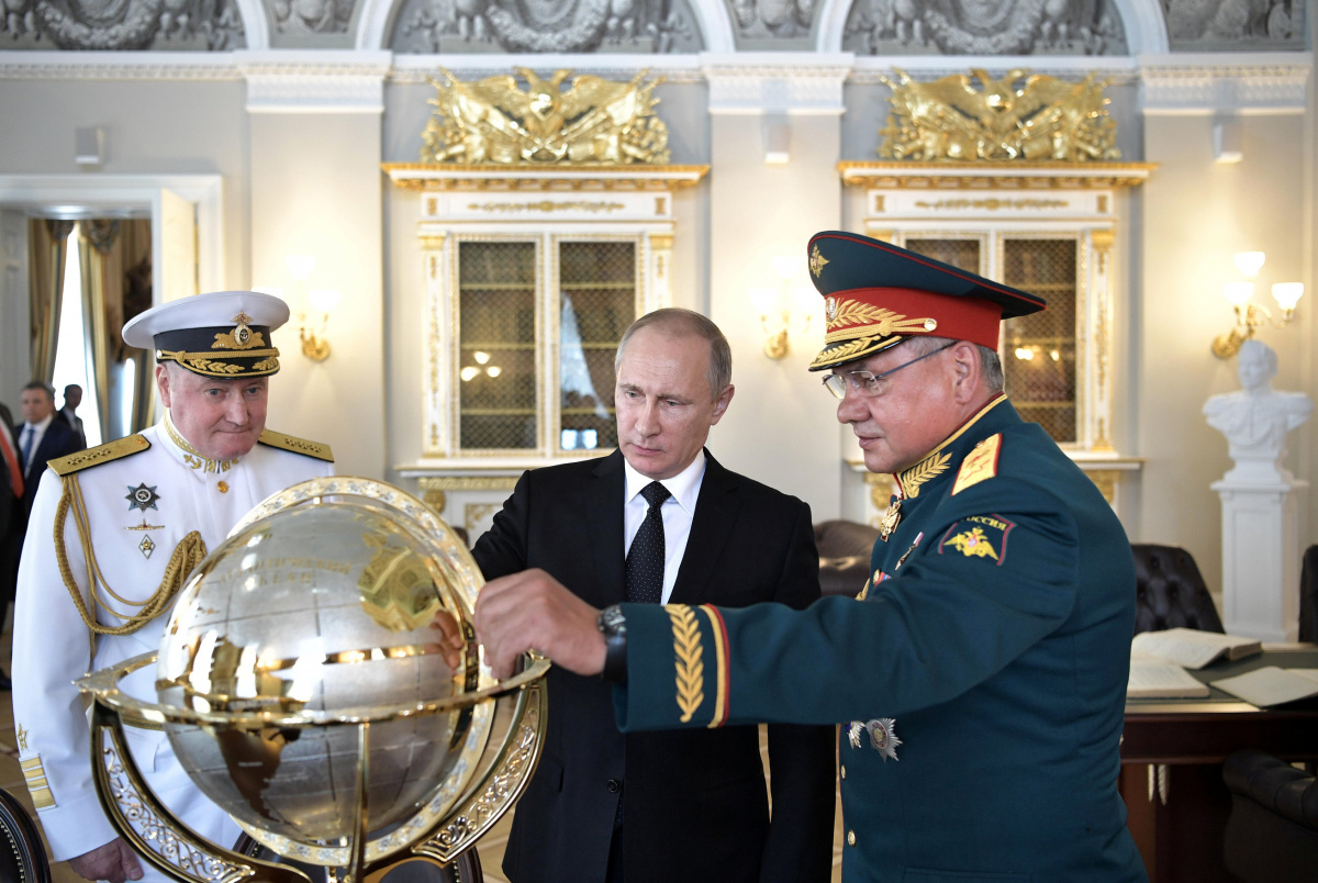Russian President Vladimir Putin (C), Defence Minister Sergei Shoigu (R) and Commander-in-Chief of the Russian Navy Vladimir Korolev visit the Admiralty historical building on the Navy Day in St. Petersburg, Russia, July 30, 2017. Sputnik/Alexei Nikolsky/Kremlin via REUTERS
