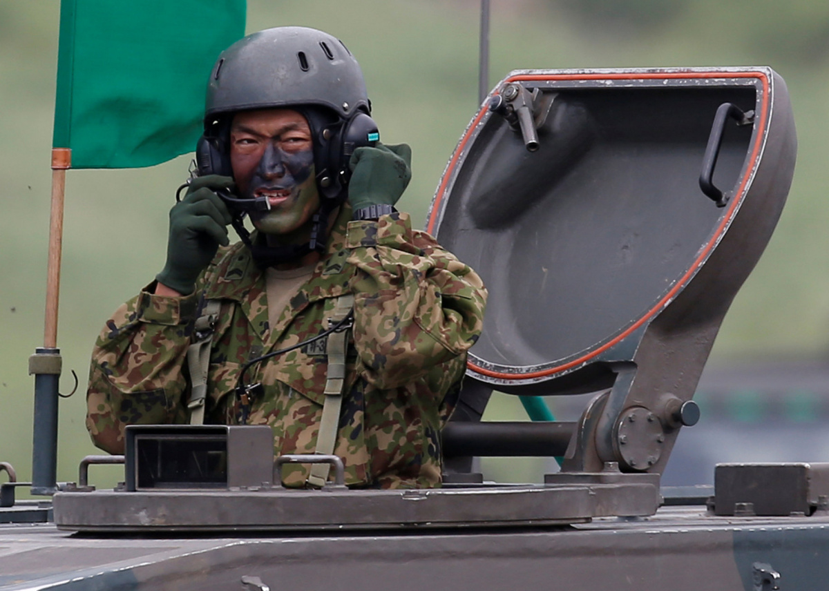 A Japanese Ground Self-Defense Force soldier takes part in an annual training session at Higashifuji training field in Gotemba, west of Tokyo, Japan August 24, 2017. REUTERS/Issei Kato