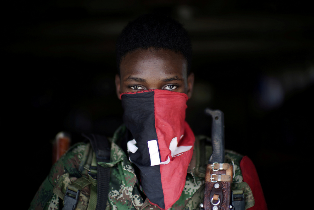 A rebel from Colombia's Marxist National Liberation Army (ELN) poses for a photograph in the northwestern jungles, in Colombia, August 31, 2017. Picture taken August 31, 2017. REUTERS/Federico Rios