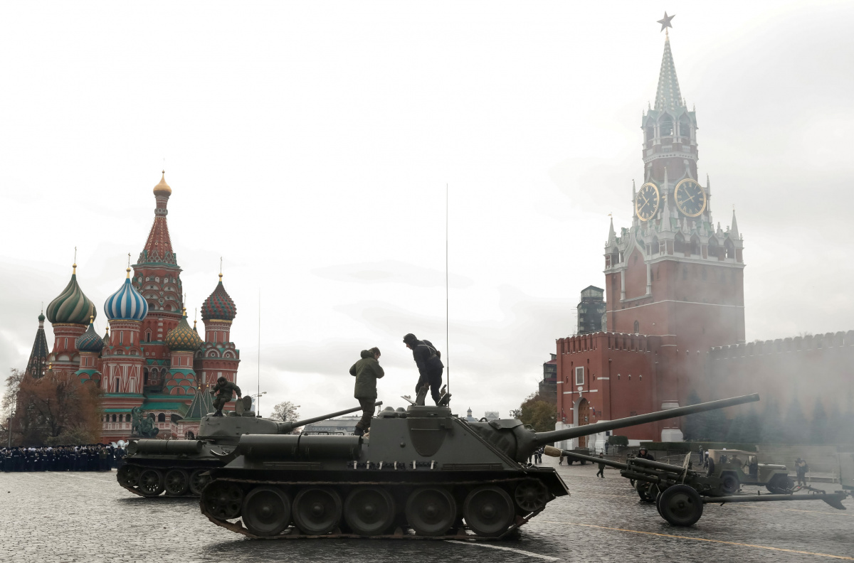 Russian Army members ride on historical tanks, during a rehearsal for a military parade to mark the anniversary of a historical parade in 1941, when Soviet soldiers marched towards the front lines at the Red Square in Moscow, Russia November 5, 2017. REUTERS/Grigory Dukor
