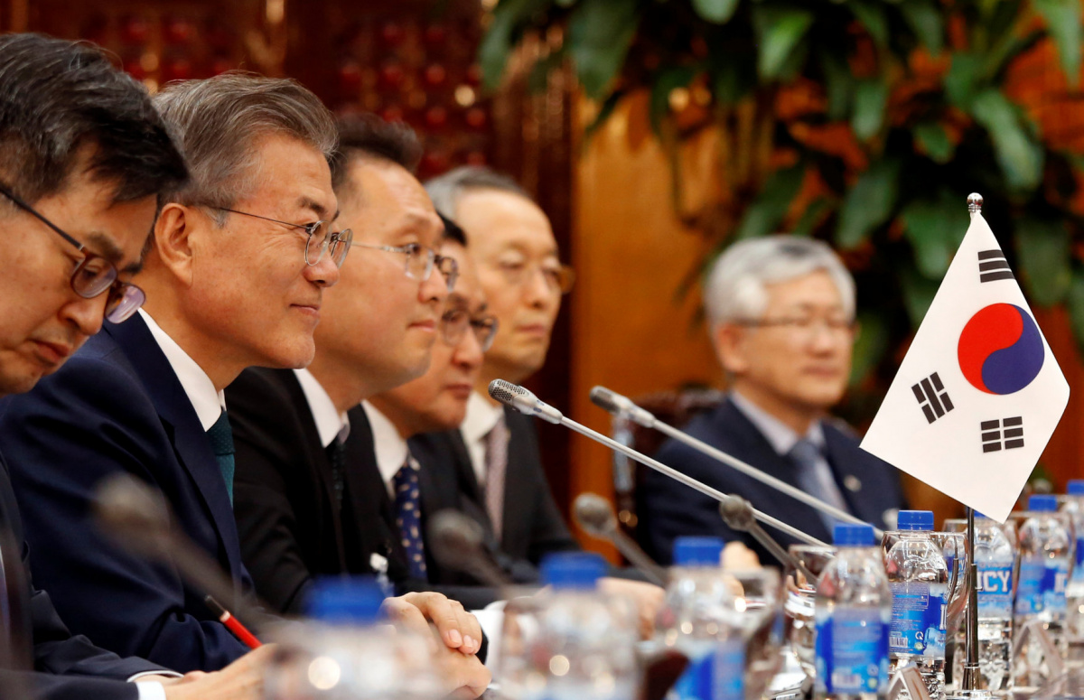 South Korea's President Moon Jae-in (2nd L) is seen during a meeting with Vietnam's Prime Minister Nguyen Xuan Phuc (not pictured) at the Government Office in Hanoi, Vietnam March 23, 2018. REUTERS/Kham/Pool