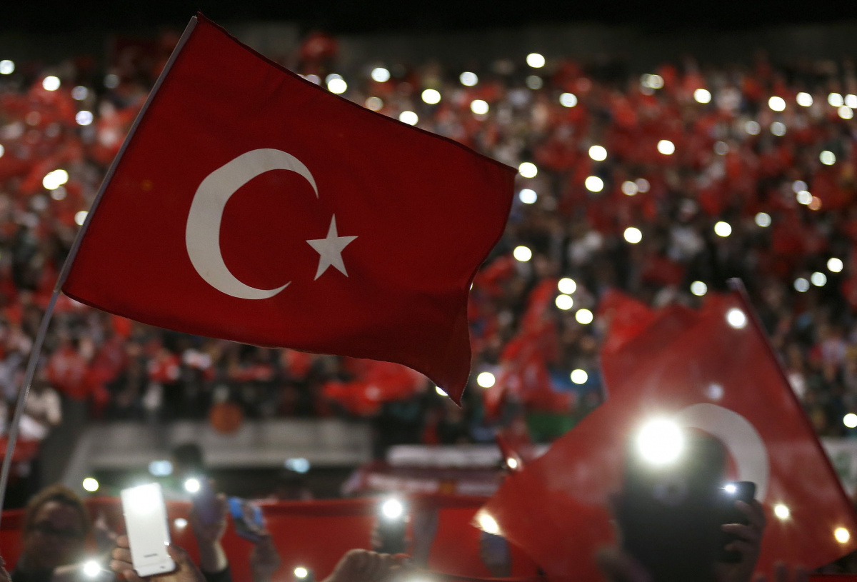 Supporters of Turkey's President Tayyip Erdogan wave Turkey's national flags as they wait for his speech during a rally against terrorism in Strasbourg, France, October 4, 2015. Some 30000 supporters coming from several countries including France, Germany, and Switzerland gathered in Strasbourg on Sunday to listen to Turkish President Recep Tayyip Erdogan's address. REUTERS/Vincent Kessler