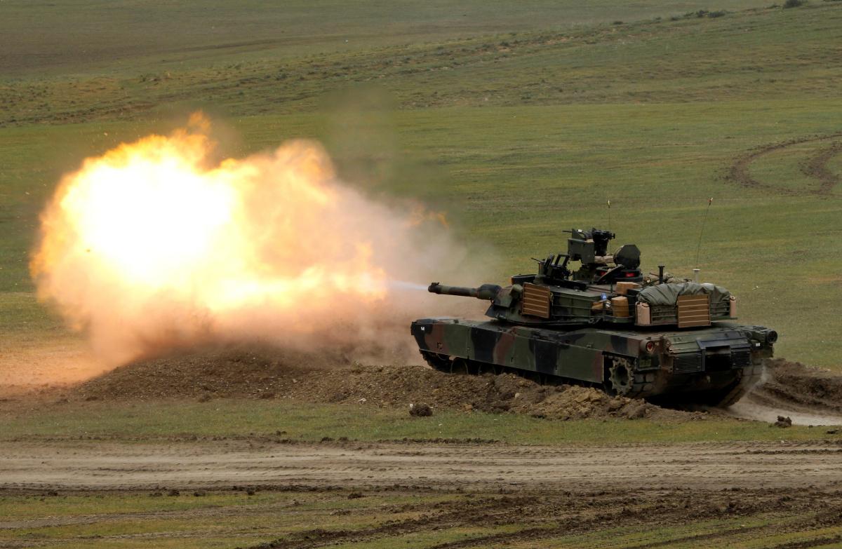 "U.S. M1A2 ""Abrams"" tank fires during U.S. led joint military exercise ""Noble Partner 2016"" near Vaziani, Georgia, May 18, 2016. REUTERS/David Mdzinarishvili"