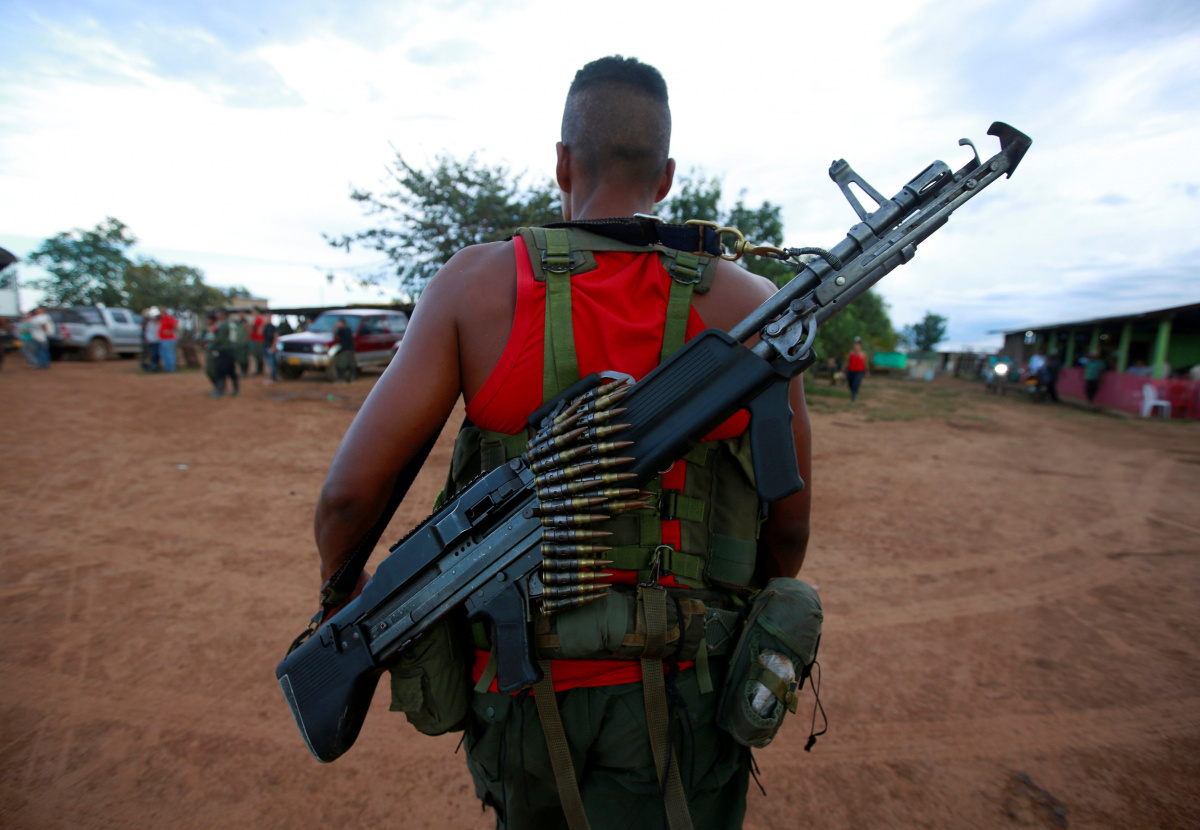 A fighter from Revolutionary Armed Forces of Colombia (FARC), arriving at the camp where they prepare for an upcoming congress ratifying a peace deal with the government, near El Diamante in Yari Plains, Colombia, September 16, 2016. REUTERS /John Vizcaino
