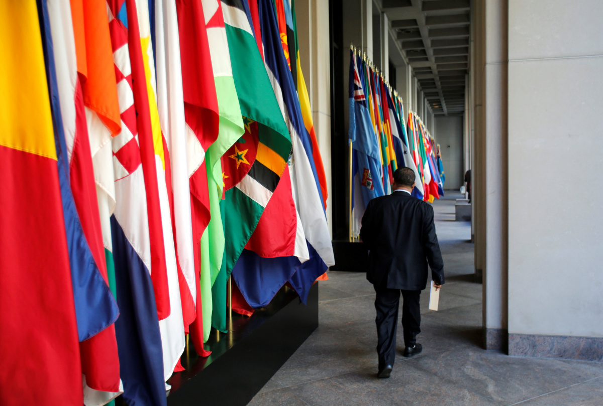A delegate walks outside International Monetary Fund headquarters after closing of the IMF/World Bank annual meetings in Washington, U.S., October 9, 2016. REUTERS/Yuri Gripas