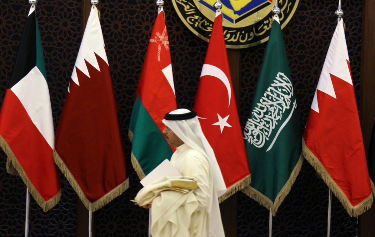 A coordinator walks past a Turkish flag and flags of Gulf Cooperation Council (GCC) before a meeting in Riyadh, Saudi Arabia, October 13, 2016. REUTERS/Faisal Al Nasser