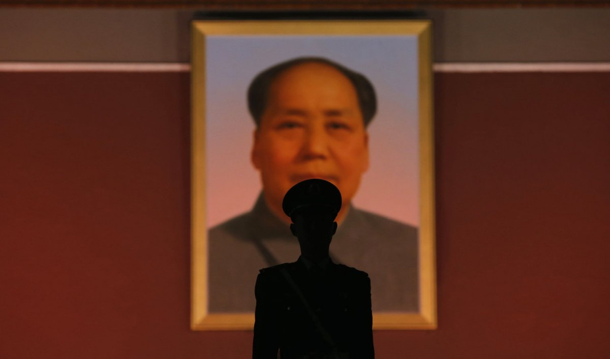 A paramilitary policeman stands guard in front of the giant portrait of late Chinese Chairman Mao Zedong at the main entrance of the Forbidden City in Beijing, October 28, 2013. Five people were killed and dozens injured on Monday, the government said, when a car ploughed into pedestrians and caught fire in Beijing's Tiananmen Square, the site of 1989 pro-democracy protests bloodily suppressed by the military. The car crashed almost directly in front of the main entrance of the Forbidden City, where there h