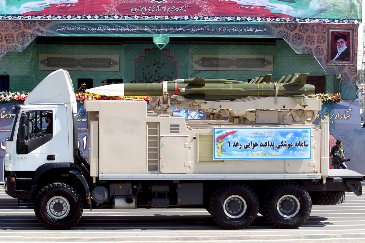 A military truck carrying a Raad missile drives past a picture of Iran's Supreme Leader Ayatollah Ali Khamenei (R) during a parade marking the anniversary of the Iran-Iraq war (1980-88), in Tehran September 22, 2015. REUTERS/Raheb Homavandi