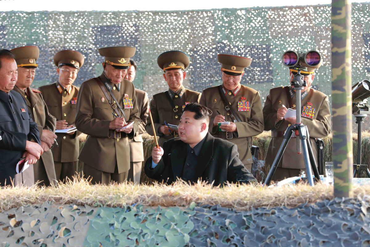 North Korean leader Kim Jong Un watches a rocket firing drill by anti-aircraft units of the Korean People's Army (KPA) in this undated photo released by North Korea's Korean Central News Agency (KCNA) in Pyongyang November 3, 2015. REUTERS/KCNA