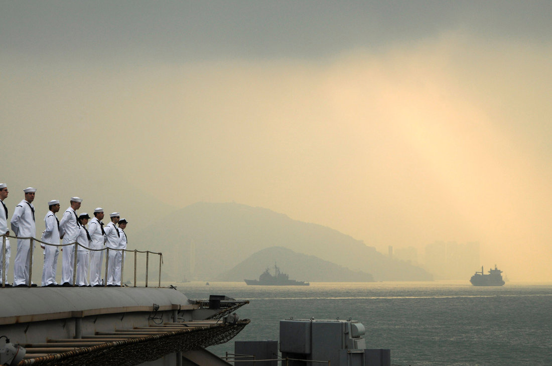 Sailors aboard the aircraft carrier USS George Washington man the rails as the ship pulls out of Hong Kong after a five-day port visit in this U.S. Navy handout photo dated November 14, 2011. REUTERS/U.S. Navy/Mass Communication Specialist Seaman Erin Devenberg