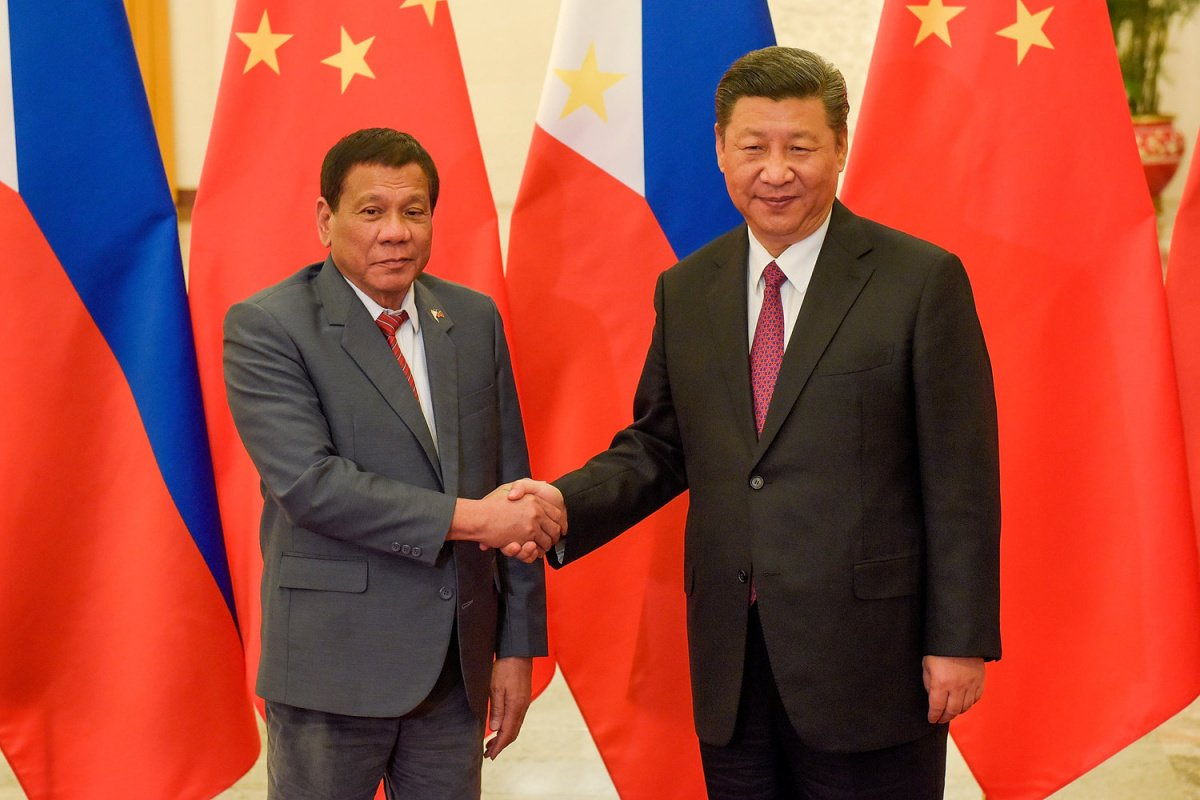 Chinese President Xi Jinping (R) shakes hands with Philippines President Rodrigo Duterte prior to their bilateral meeting during the Belt and Road Forum, at the Great Hall of the People in Beijing, China May 15, 2017. REUTERS/Etienne Oliveau/Pool