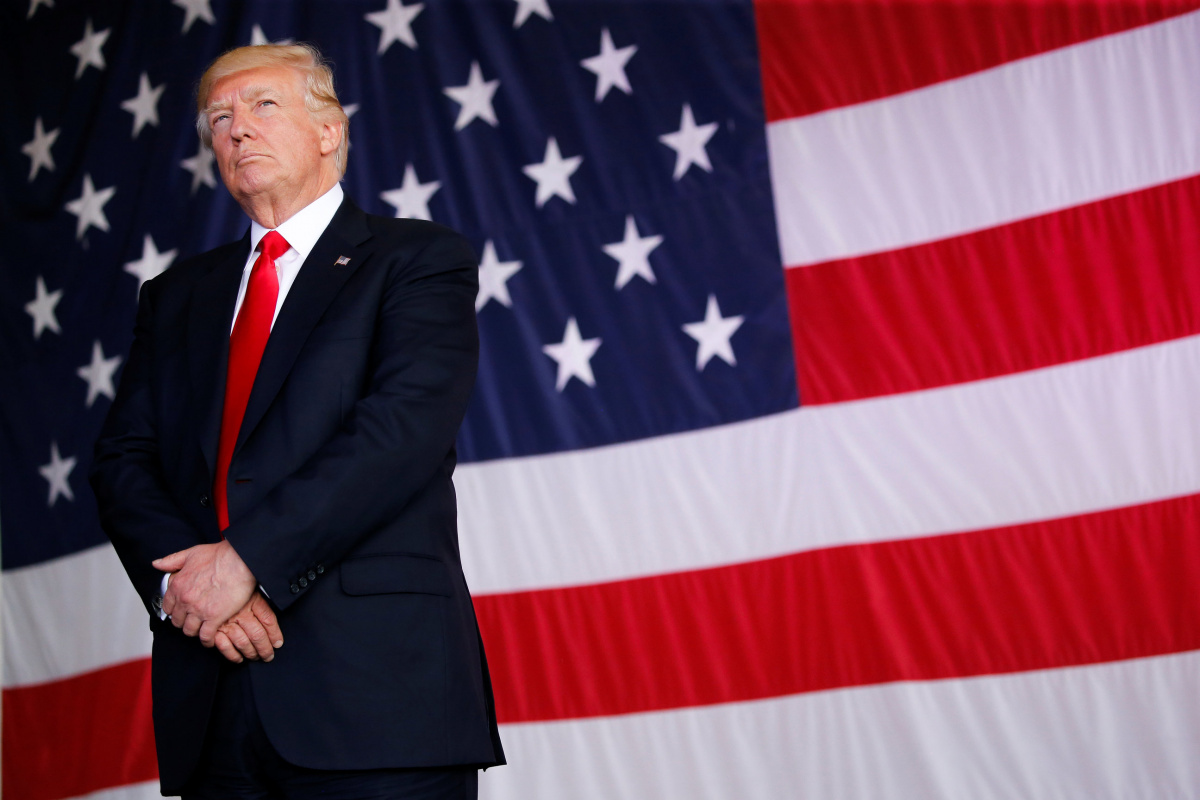 Image: U.S. President Donald Trump stands in front of a U.S. flag while listening to U.S. first lady Melania Trump give a speech to U.S. troops at the Naval Air Station Sigonella before returning to Washington D.C. at Sigonella Air Force Base in Sigonella, Sicily, Italy, May 27, 2017REUTERS/Jonathan Ernst