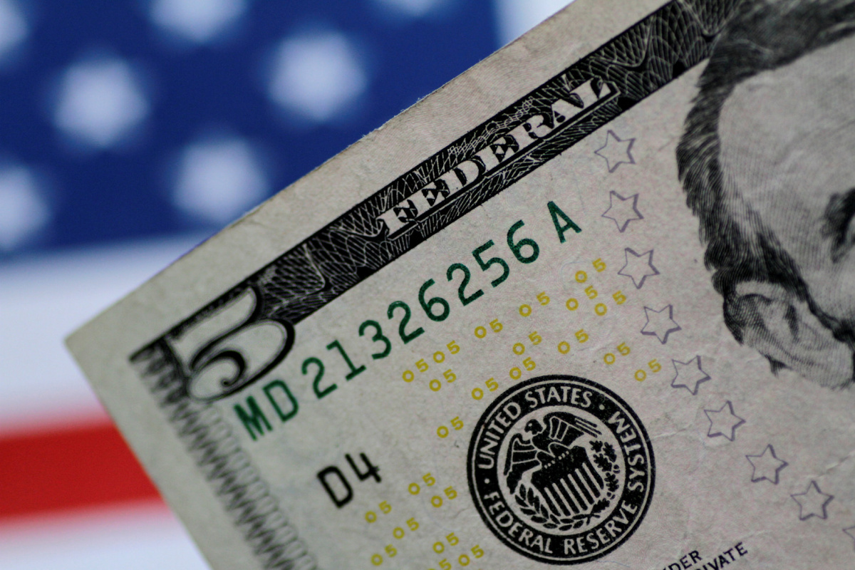 A U.S. five dollar note is seen in this illustration photo June 1, 2017. REUTERS/Thomas White/Illustration