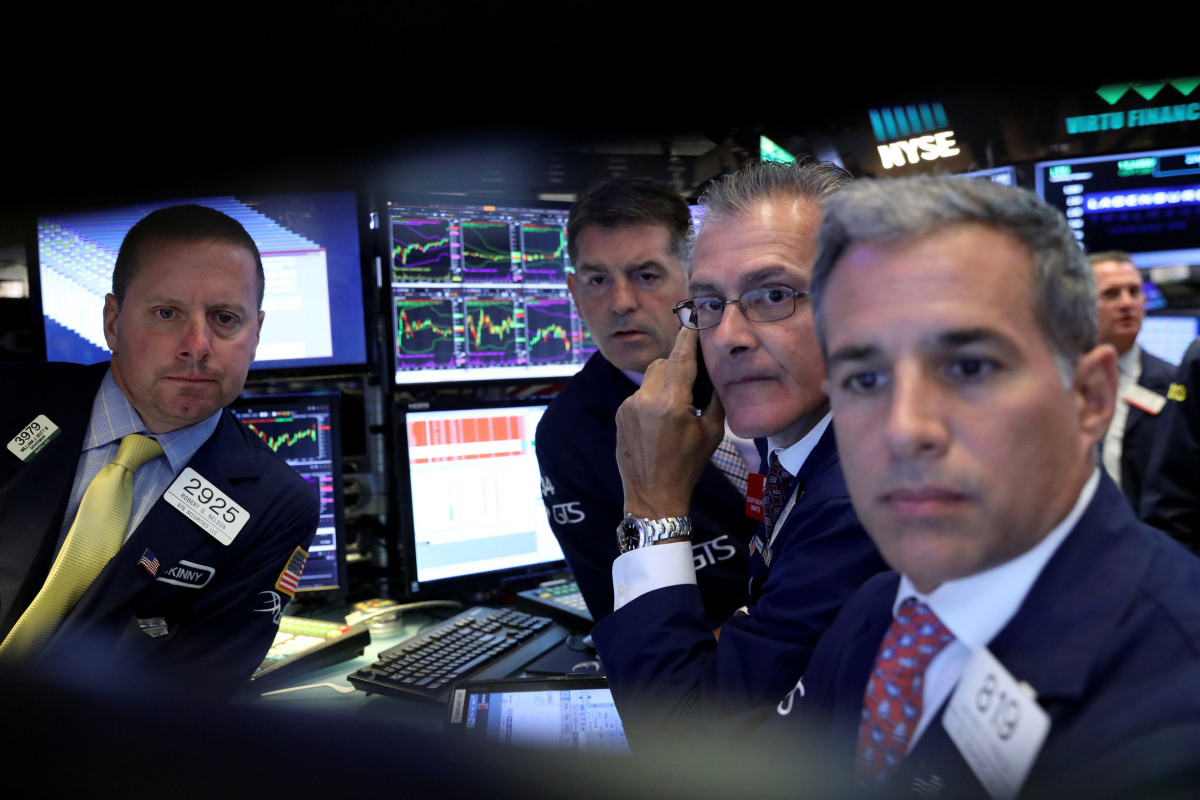 A screen displays trading information for German insurance firm Allianz on the floor of the New York Stock Exchange (NYSE) in New York, U.S., July 19, 2017. REUTERS/Brendan McDermid