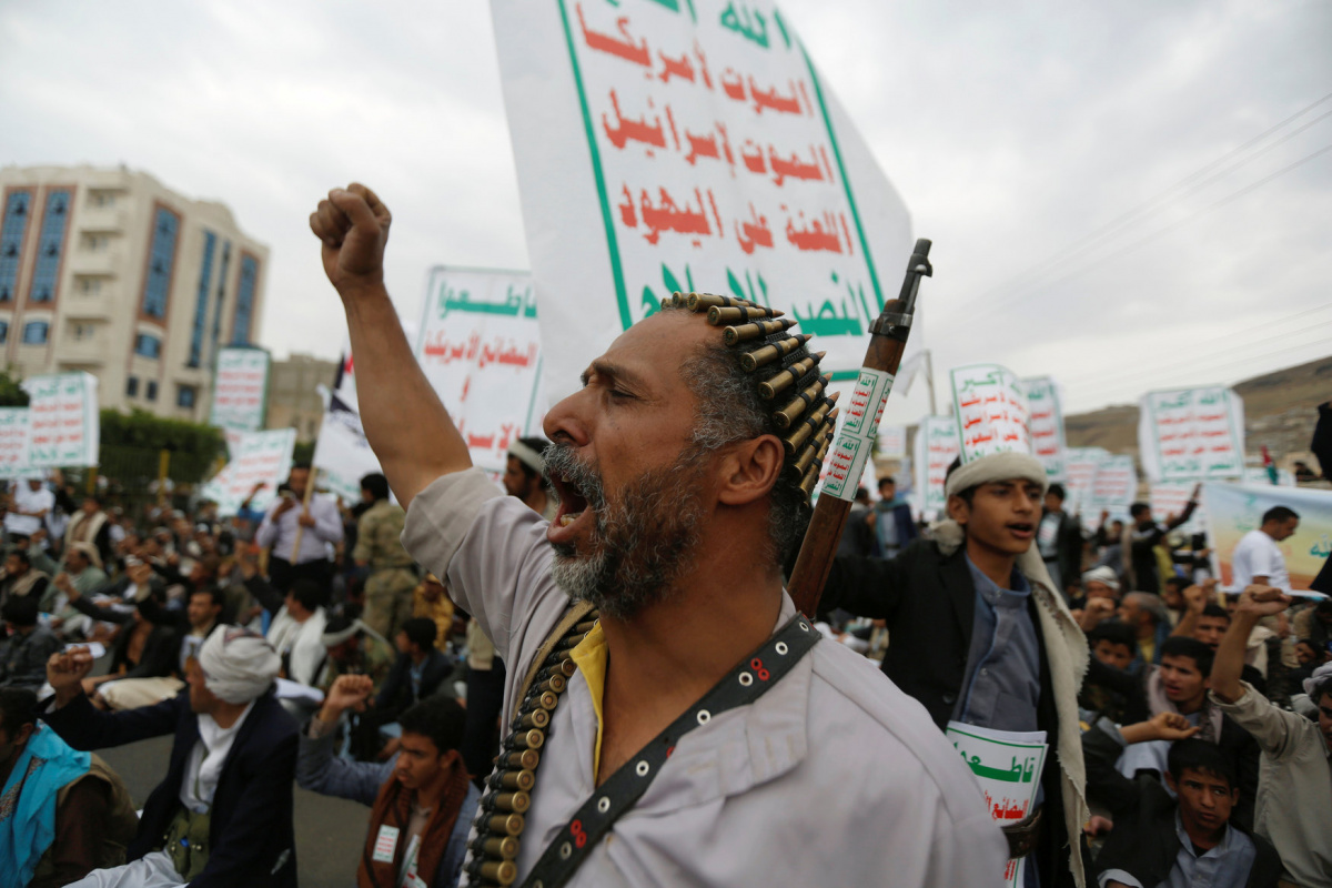 """A man shouts slogans during an anti-Israeli rally to show solidarity with Al-Aqsa mosque, in Sanaa, Yemen July 21, 2017. The placards read: """"Allah is the greatest. Death to America, death to Israel, a curse on the Jews, victory to Islam"""" and """"Boycott the American and Israeli goods!"""". REUTERS/Khaled Abdullah"""