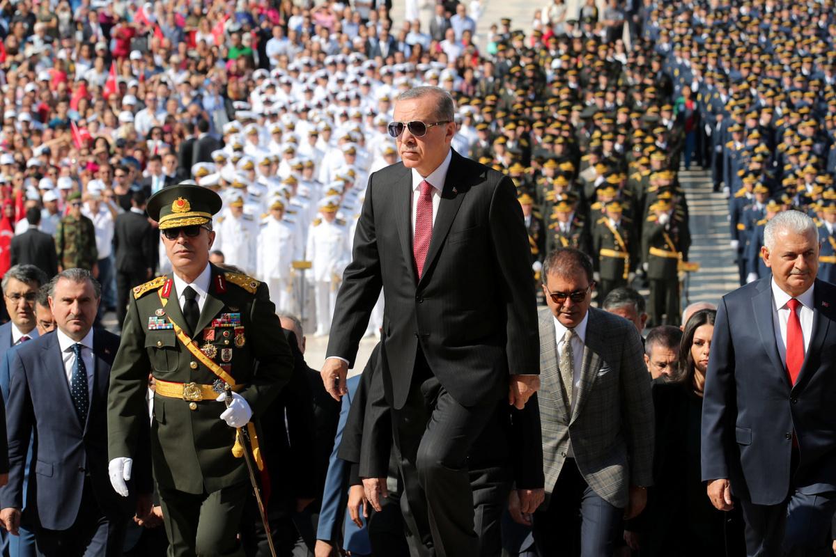 Turkish President Tayyip Erdogan attends a ceremony marking the 95th anniversary of Victory Day at the mausoleum of Mustafa Kemal Ataturk in Ankara, Turkey August 30, 2017. REUTERS/Umit Bektas