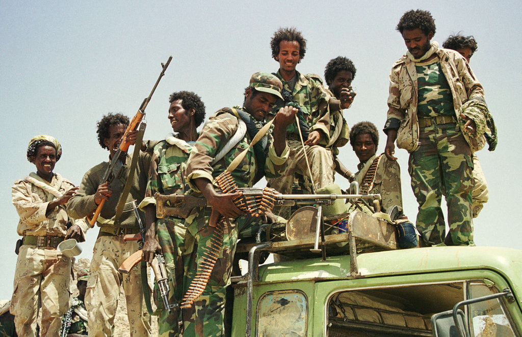 Jubilant Eritrean troops show off their weapons after recapturing the western Eritrean town of Tesseney from Ethiopian forces June 6. The Eritrean government said on Tuesday it had recaptured the town from Ethiopian forces after a day-long battle which forced thousands more civilians from their homes, adding to the region's humanitarian crisis.