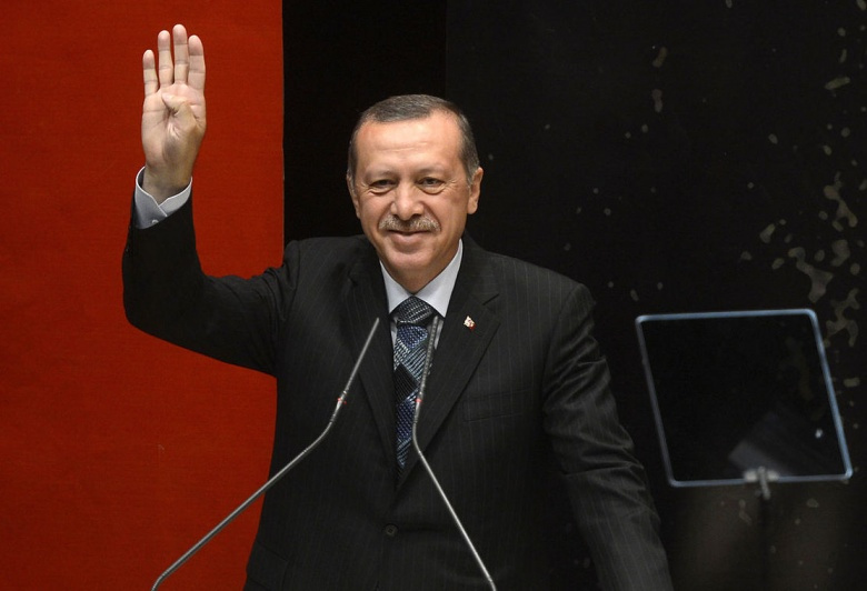 Turkish Prime Minister Recep Tayyip Erdoğan making the Rabia sign.​ Wikimedia Commons/Public domain