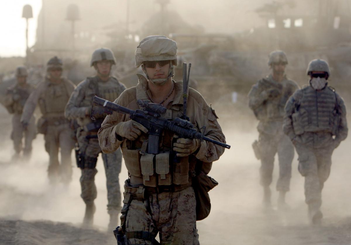 U.S. Marines patrol near the town of Khan Neshin, Helmand Province, southern Afghanistan. Reuters/Goran Tomasevic.