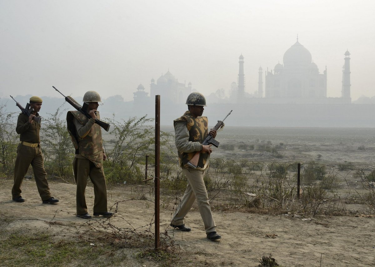 Indian security personnel patrol on the rear side of the historic Taj Mahal
