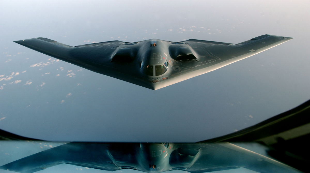"""A B-2 Spirit proceeds to an undisclosed location after flying a mission over Iraq, March 27, 2003. A U.S. B-2 bomber on Friday dropped two earth-shattering 4,600-pound (2,086 kg) """"bunker-buster"""" bombs on a downtown Baghdad communications tower, defense officials said. it was the first use of the big bombs in a week-long pounding of the Iraqi capital. U.S.-led jets and ships have used more than 5,000 bombs and missiles against Baghdad and across Iraq in a war to depose President Saddam Hussein. REUTERS/Cheri"""