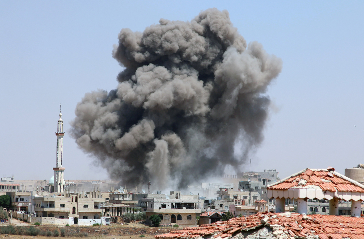 Smoke rises after airstrikes on a rebel-held part of the southern city of Deraa, Syria, June 15, 2017.