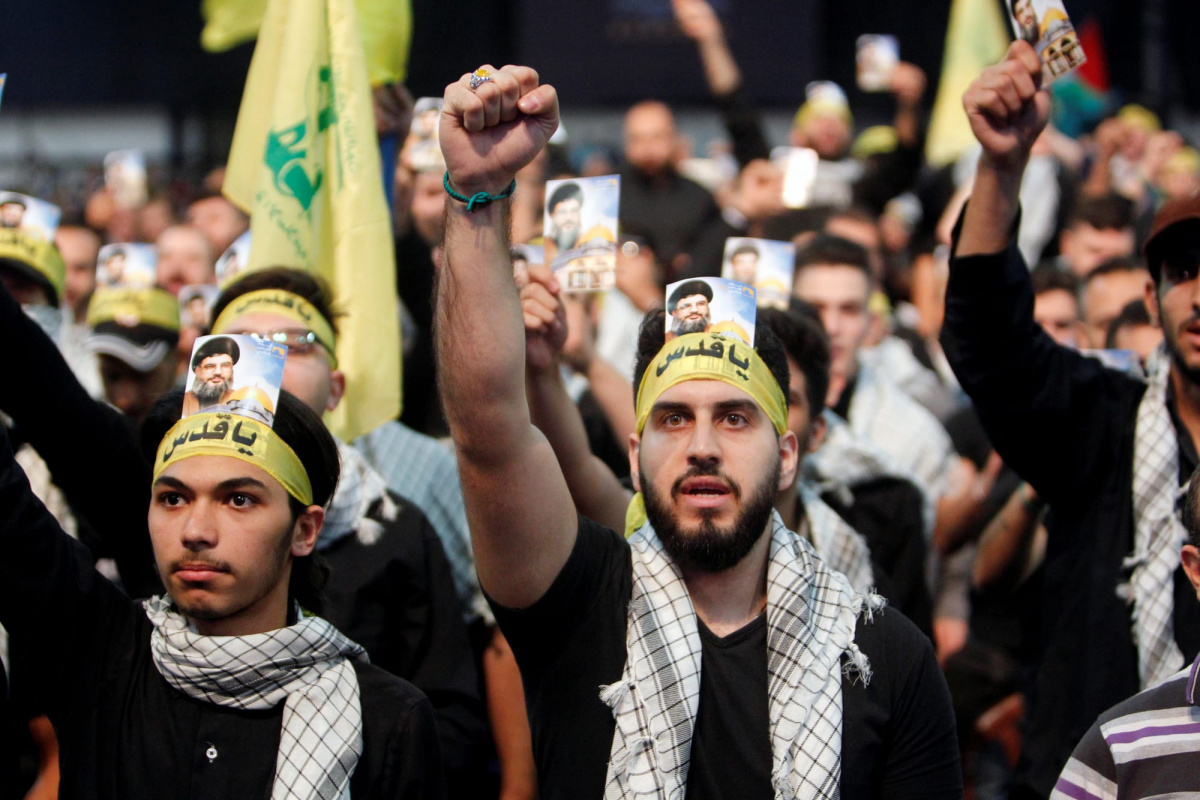 Supporters of Lebanon's Hezbollah leader Sayyed Hassan Nasrallah chant slogans and gesture during a rally marking Al-Quds day in Beirut's southern suburbs, Lebanon