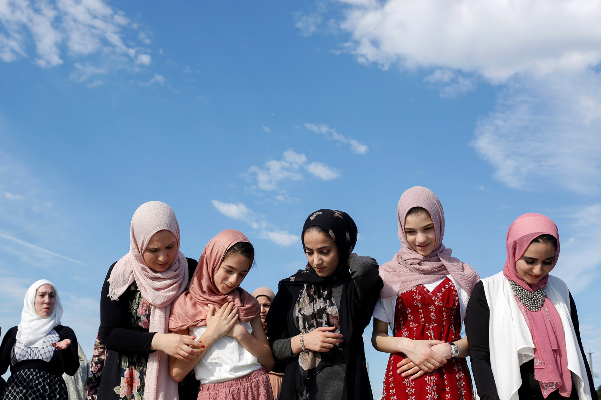 Muslim women prepare to take part in Eid al-Fitr prayers in Staten Island