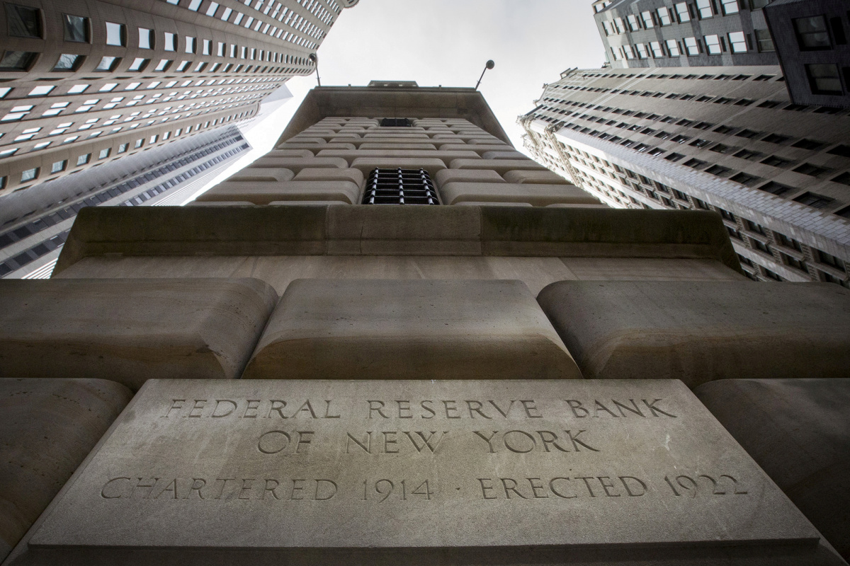 The corner stone of the New York Federal Reserve Bank is seen surrounded by financial institutions in New York City, New York, U.S., March 25, 2015.