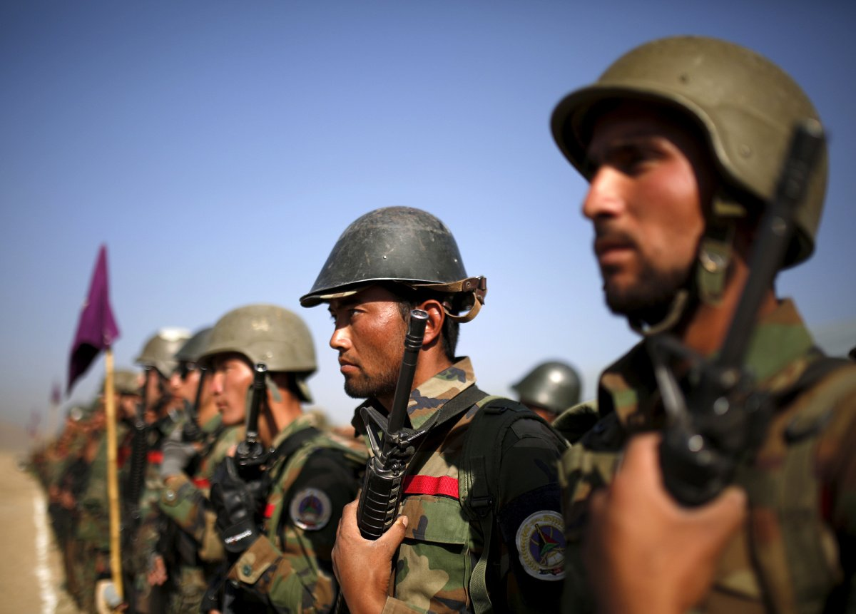 Afghan National Army (ANA) officers stand at attention during a training exercise at the Kabul Military Training Centre in Afghanistan October 7, 2015.