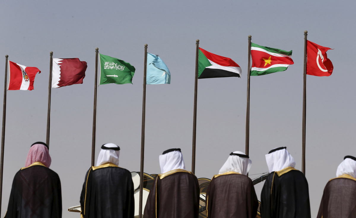 Saudi officials wait to receive leaders attending the Summit of South American-Arab Countries in Riyadh