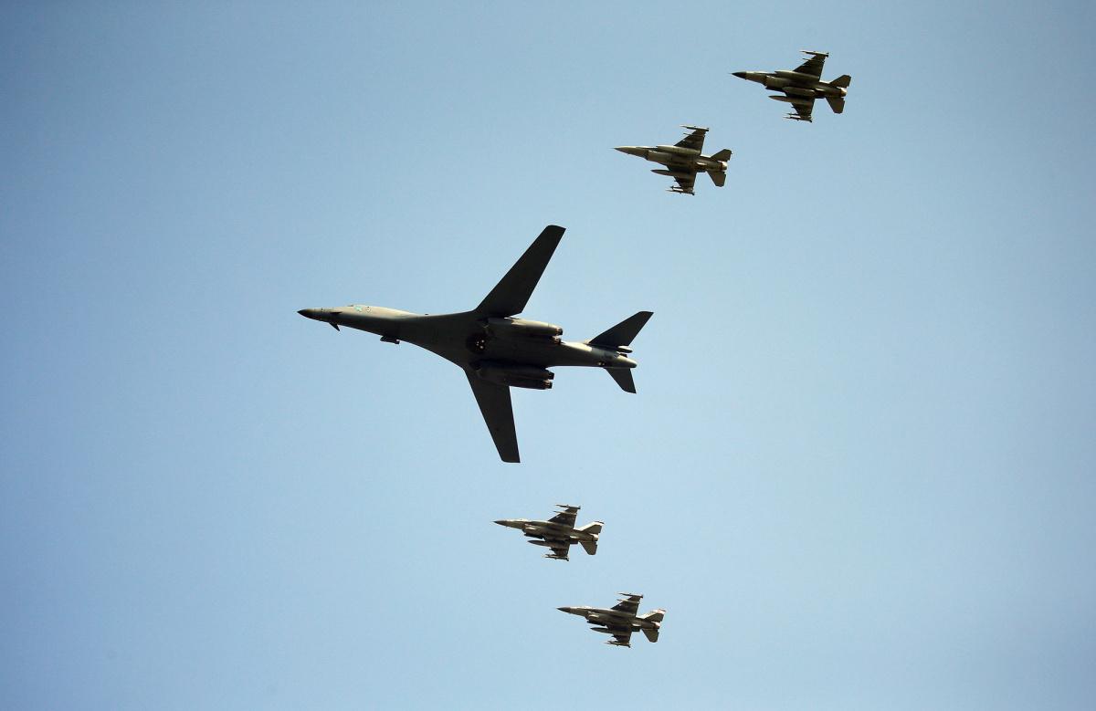 A U.S. Air Force B-1B bomber flies over Osan Air Base in Pyeongtaek, South Korea