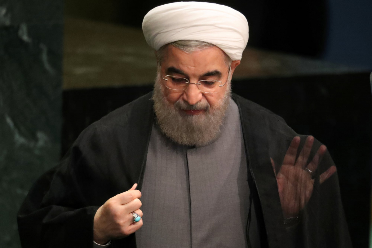 Iran's President Hassan Rouhani adjusts his clothes after he addressed the 71st United Nations General Assembly in Manhattan, New York