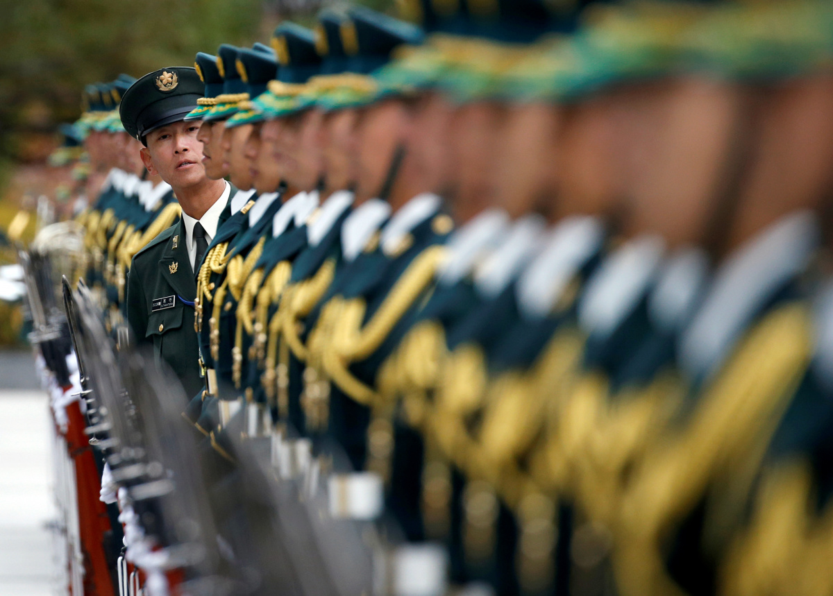 Members of Japan's Self-Defence Force's honour guard prepare for a ceremony for U.S. Defense Secretary Ash Carter at the Defense Ministry in Tokyo, Japan.