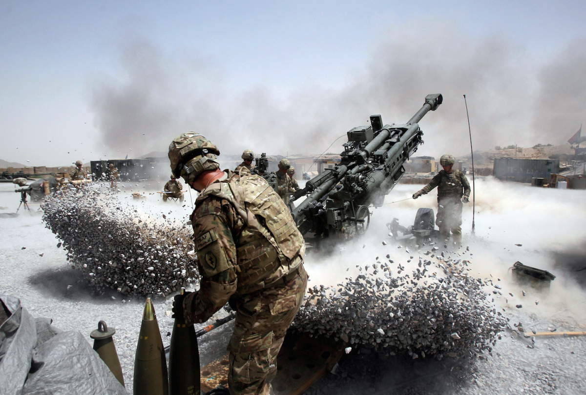 U.S. Army soldiers from the 2nd Platoon, B battery 2-8 field artillery, fire a howitzer artillery piece at Seprwan Ghar forward fire base in Panjwai district, Kandahar province southern Afghanistan.