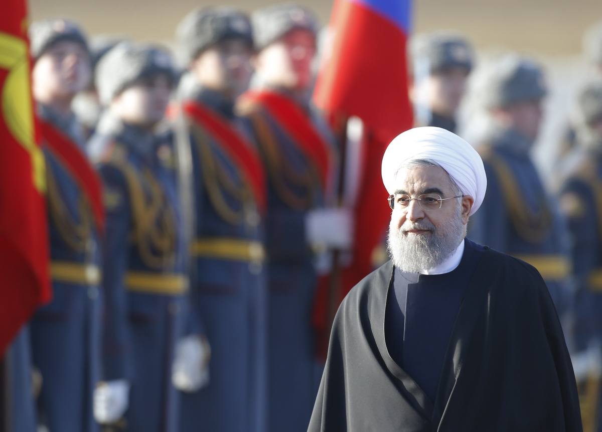 Iranian President Hassan Rouhani inspects the honour guard during a welcoming ceremony upon his arrival at Vnukovo International Airport in Moscow