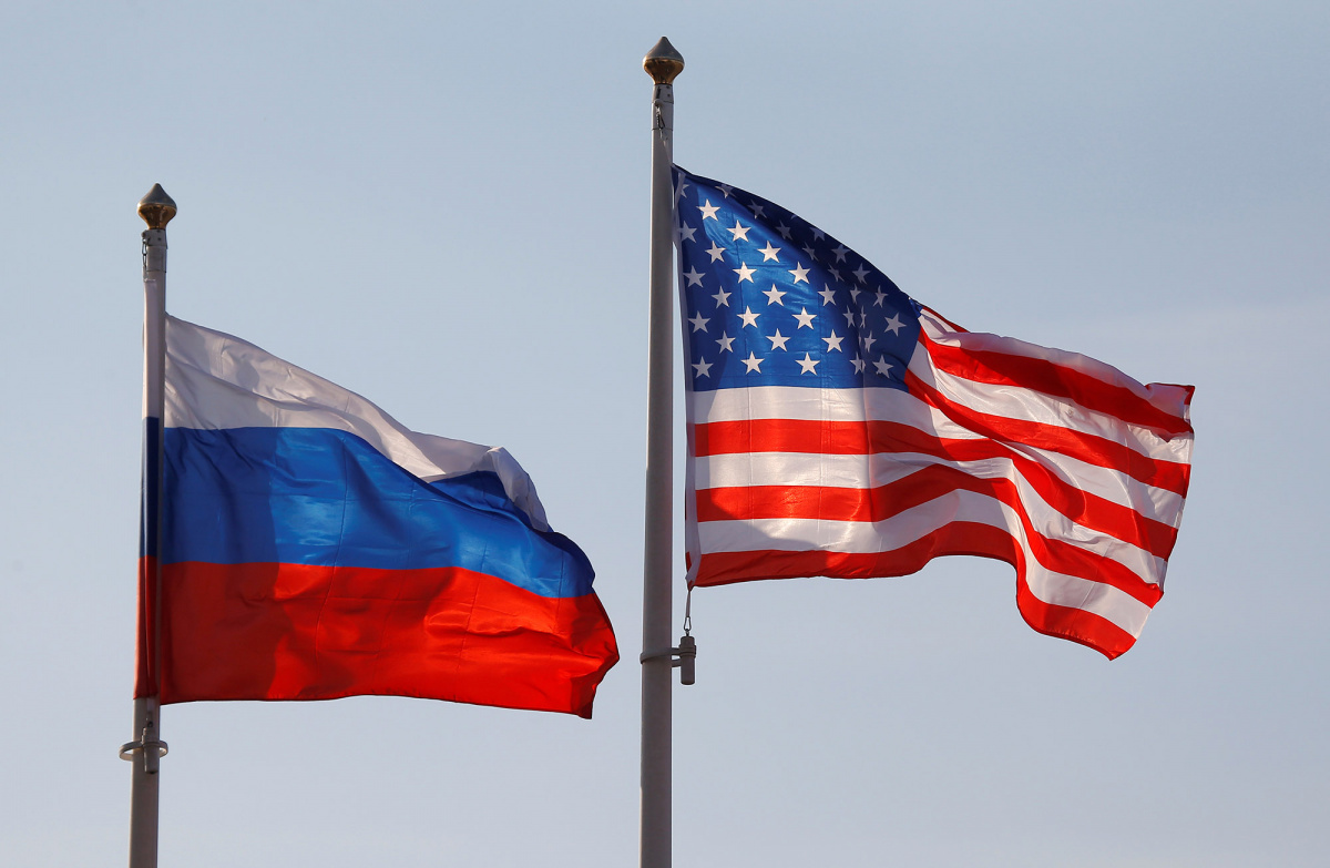 National flags of Russia and the U.S. fly at Vnukovo International Airport in Moscow,