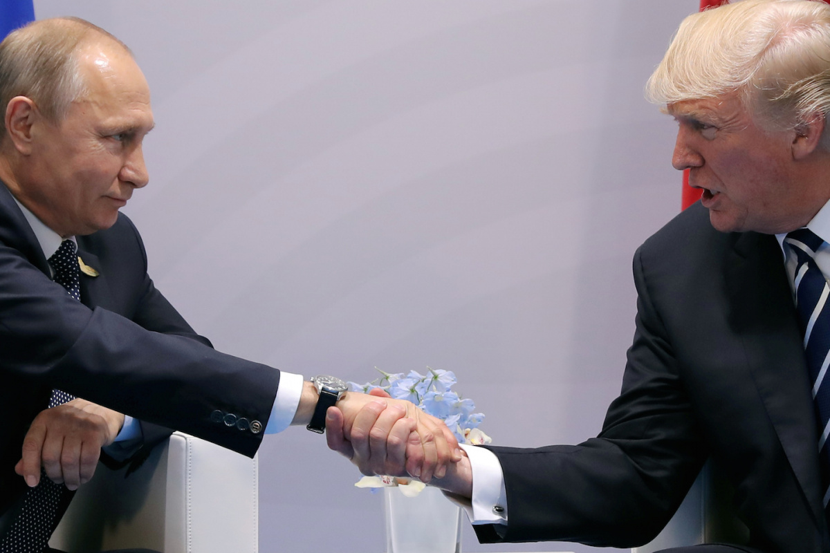 U.S. President Donald Trump shakes hands with Russian President Vladimir Putin during the their bilateral meeting at the G20 summit in Hamburg, Germany July 7, 2017. REUTERS/Carlos Barria