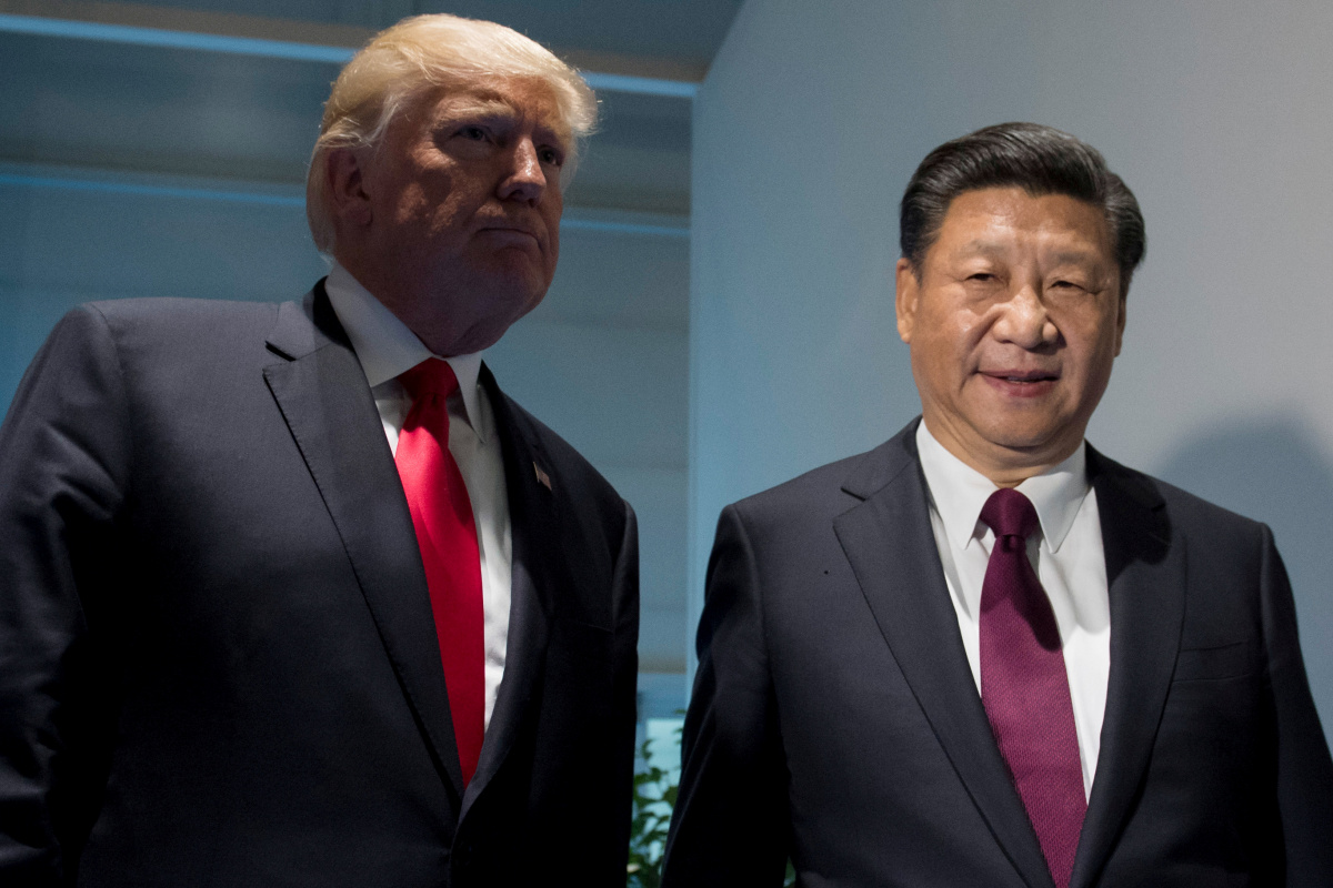 U.S. President Donald Trump and Chinese President Xi Jinping (R) meet on the sidelines of the G20 Summit in Hamburg, Germany
