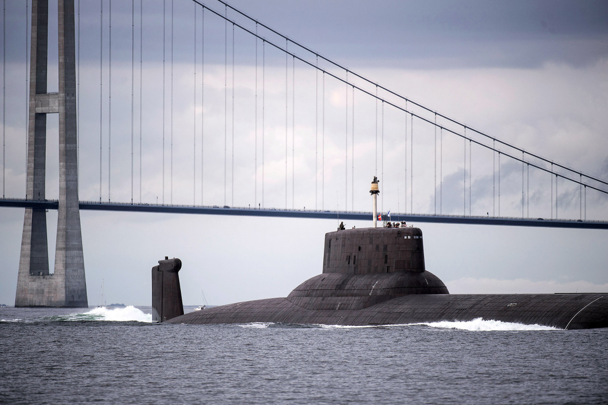 The Russian nuclear submarine Dmitry Donskoy sails under the Great Belt Bridge in Denmark