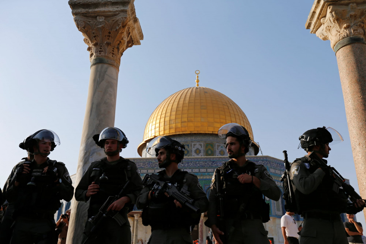 Israeli security forces stand at the compound known to Muslims as Noble Sanctuary and to Jews as Temple Mount, after Israel removed all security measures it had installed at the compound, and Palestinians entered the compound in Jerusalem's Old City