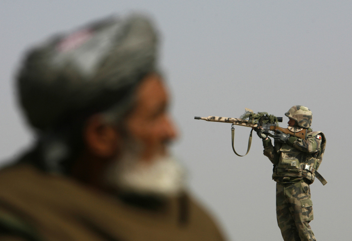 A French sniper looks through his rifle's scope while keeping watch over Qarabagh district, about 40 km (25 miles) north of Kabul, November 20, 2007. REUTERS/Ahmad Masood