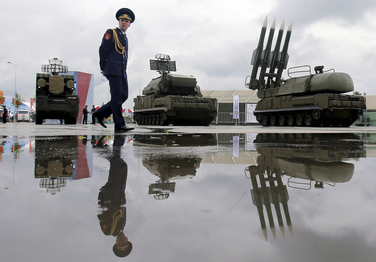 A Russian serviceman walks past the Buk-1M missile system at the Army-2015 international military forum in Kubinka, outside Moscow, Russia