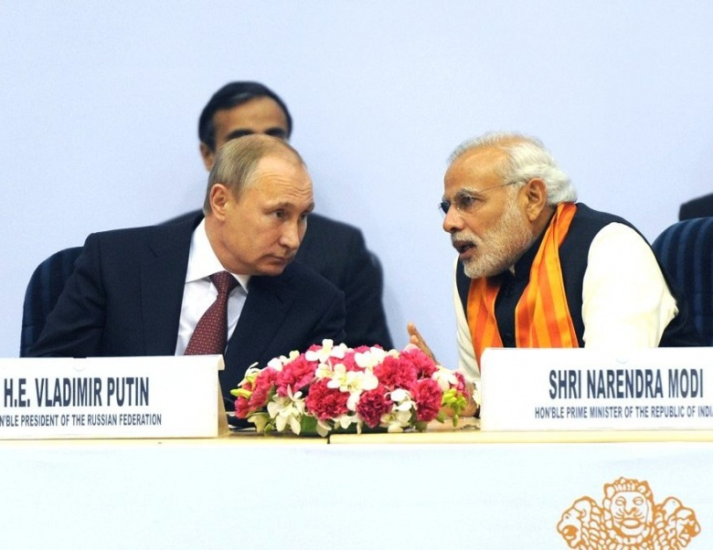 Vladimir Putin at the World Diamond Conference with Narendra Modi. Wikimedia Commons/Kremlin.ru