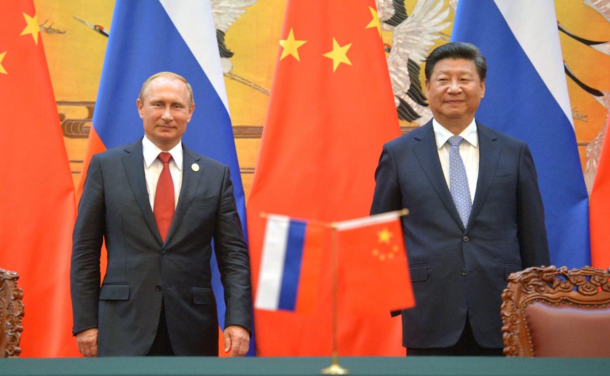 Vladimir Putin with Xi Jinping. Kremlin.ru